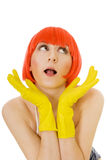 Carefree woman in red wig and yellow gloves