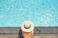 Carefree woman relaxation in swimming pool summer Holiday concept stock photos