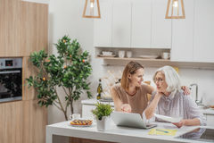 Carefree woman showing mom how computer works Royalty Free Stock Images