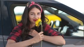 Carefree woman smelling sunflower on roadtrip stock footage