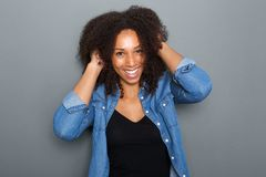 Carefree woman smiling with hand in hair Stock Image