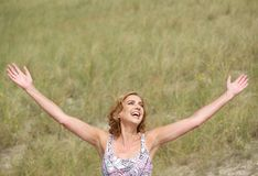 Carefree woman standing with arms outstretched Royalty Free Stock Images