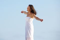 Carefree woman standing outside with arms spread open Royalty Free Stock Photography