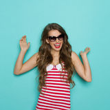 Carefree Woman In Striped Shirt Royalty Free Stock Photography