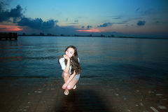 Carefree woman in the sunset by Dishui lake in Shanghai, healthy living concept, pure happiness and freedom. Serene woman. beautiful and charming woman, with Stock Photo