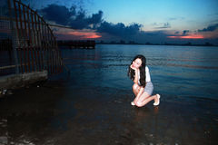 Carefree woman in the sunset by Dishui lake in Shanghai, healthy living concept, pure happiness and freedom. Serene woman. beautiful and charming woman, with Royalty Free Stock Photos