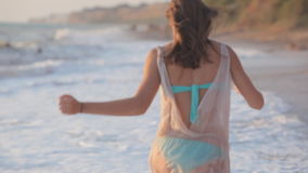 Carefree woman in sunset on the island beach. stock video footage