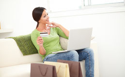 Carefree woman using a credit card Stock Photo