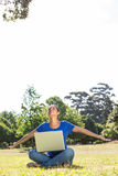 Carefree woman using laptop in park Stock Images
