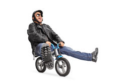 Carefree young biker riding a small bicycle Royalty Free Stock Photography