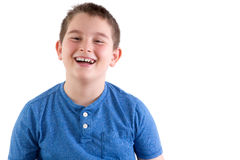 Carefree young boy enjoying a good laugh Royalty Free Stock Photo