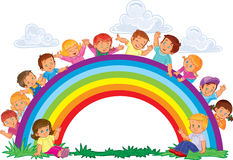 Carefree young children and rainbow Stock Image