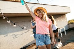 Carefree girl enjoying party on rooftop terrace stock photos