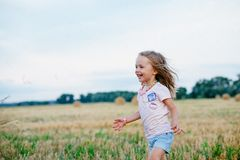 Carefree young girl in stubble field