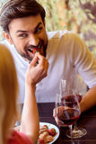 Carefree young lovers enjoying food in cafe Stock Photography