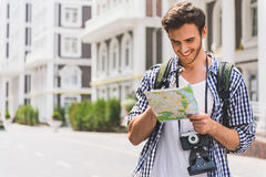 Carefree young man searching for place of destination Stock Image