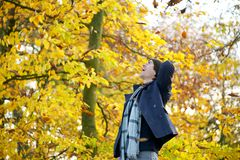Carefree young man standing outside looking up royalty free stock photography