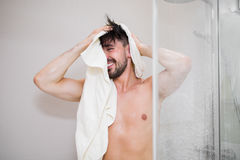 Carefree young man after taking shower Stock Photo