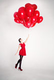 Carefree Young Woman with Balloons Royalty Free Stock Image