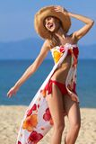 Carefree young woman on the beach Stock Photo