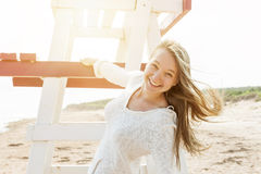 Carefree young woman on beach Stock Image