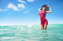 Carefree young woman enjoying clear tropical water Royalty Free Stock Images