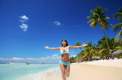 Carefree young woman enjoying clear water of the carribean sea Royalty Free Stock Photography