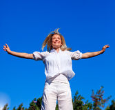 Carefree young woman enjoying life. In a park Stock Photo