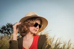 Carefree young woman in a hat Stock Images