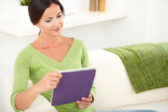 Carefree young woman holding a tablet Stock Image