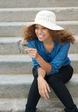 Carefree young woman laughing outdoors Royalty Free Stock Photos