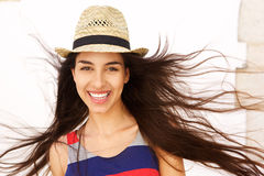 Carefree young woman with long hair blowing in the wind Stock Photos