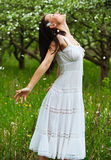 Carefree young woman in park. Portrait of carefree young woman in park Royalty Free Stock Images