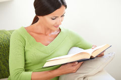 Carefree young woman reading a book Royalty Free Stock Photo
