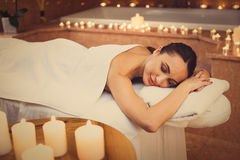 Carefree young woman relaxing at beauty salon Royalty Free Stock Images