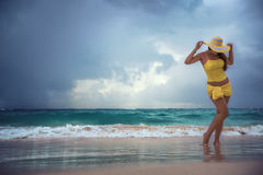 Carefree young woman relaxing on tropical beach Stock Image