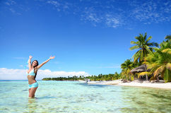 Carefree young woman relaxing on tropical beach Stock Photography