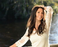 Carefree Young Woman at River Stock Photo
