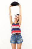 Carefree young woman smiling with arms raised Royalty Free Stock Images