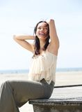 Carefree young woman smiling outdoors Royalty Free Stock Photos