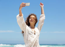 Carefree young woman taking selfie at the beach Royalty Free Stock Photos
