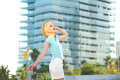 Carefree young woman walking in the city Stock Photos