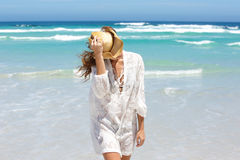 Carefree young woman by the water at the beach Royalty Free Stock Images