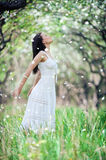 Carefree young woman in white dress. Portrait of carefree young woman in white dress stock photography