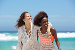 Carefree young women at the beach Royalty Free Stock Images