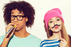 Carefree youth. Funky young couple making faces while standing against white background Royalty Free Stock Photo
