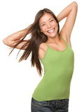 Carefree youth woman isolated. Isolated portrait of relaxed and carefree young woman isolated on white background waist up. Beautiful Caucasian Asian multiracial stock photo