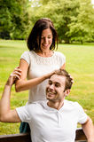 Carefree youth - young couple in love. Young happy couple together - women plying with men's hair Royalty Free Stock Photos