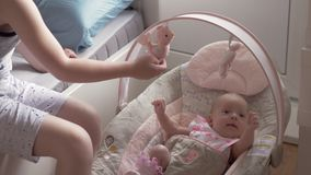 Careful brother looking after baby sister at home stock footage