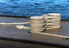 Careful bundle of rope on submarine bollard Royalty Free Stock Photography